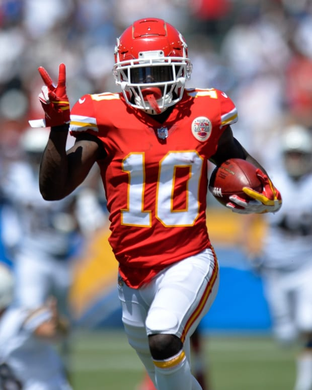 Sep 9, 2018; Carson, CA, USA; Kansas City Chiefs wide receiver Tyreek Hill (10) runs a punt back for a touchdown against the Los Angeles Chargers at StubHub Center. Mandatory Credit: Jake Roth-USA TODAY Sports