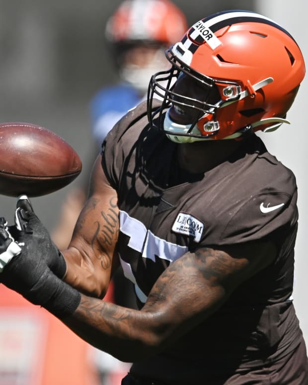 Aug 20, 2020; Berea, Ohio, USA; Cleveland Browns offensive tackle Alex Taylor (67) catches a punt during training camp at the Cleveland Browns training facility. Mandatory Credit: Ken Blaze-USA TODAY Sports