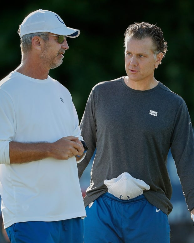 Indianapolis Colts head coach Frank Reich (left) and defensive coordinator Matt Eberflus talk during 2019 training camp.