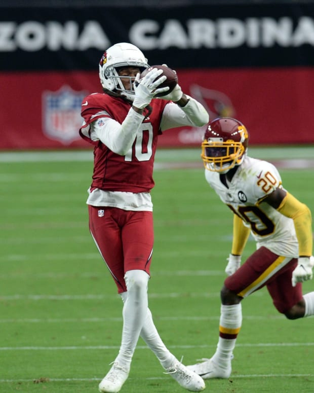 Arizona Cardinals wide receiver DeAndre Hopkins (10) makes a catch against Washington Football Team cornerback Jimmy Moreland (20) during the second half at State Farm Stadium.