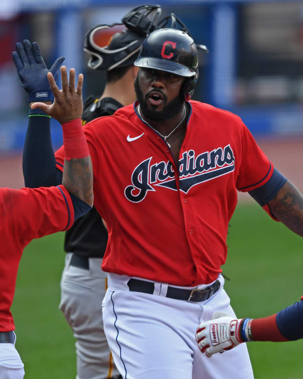 Sep 27, 2020; Cleveland, Ohio, USA; Cleveland Indians designated hitter Franmil Reyes (32) celebrates with third basemen Jose Ramirez (11) and first basemen Carlos Santana (41) after hitting a three-run home run during the sixth inning against the Pittsburgh Pirates at Progressive Field.