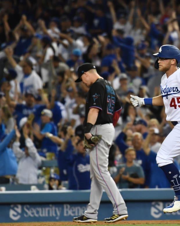 Jul 20, 2019; Los Angeles, CA, USA; Los Angeles Dodgers first baseman Matt Beaty (45) reacts after hitting a three run home run in the 8th inning against the Miami Marlins at Dodger Stadium. Mandatory Credit: Robert Hanashiro-USA TODAY Sports