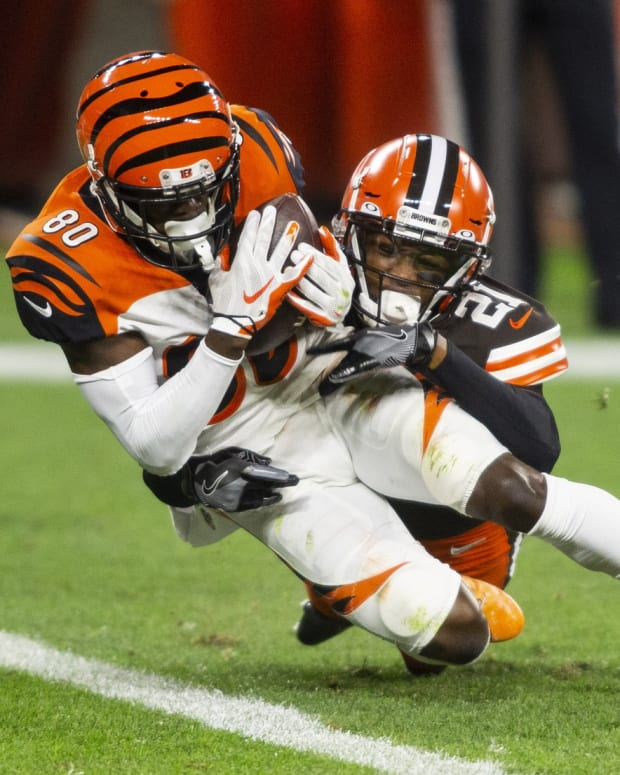 Sep 17, 2020; Cleveland, Ohio, USA; Cincinnati Bengals wide receiver Mike Thomas (80) falls into the end zone for a touchdown as Cleveland Browns cornerback Denzel Ward (21) tackles him during the fourth quarter at FirstEnergy Stadium. Mandatory Credit: Scott Galvin-USA TODAY Sports