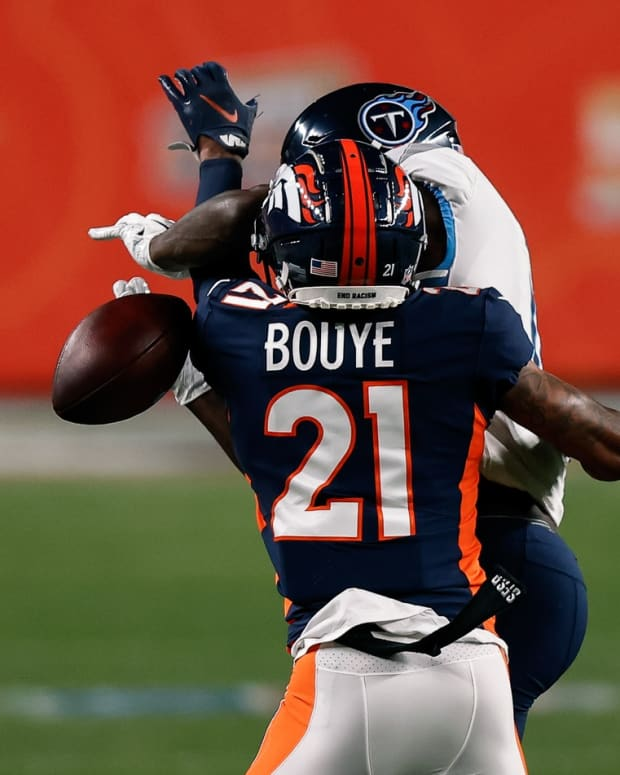 Denver Broncos cornerback A.J. Bouye (21) breaks up a pass intended for Tennessee Titans wide receiver A.J. Brown (11) in the first quarter at Empower Field at Mile High.