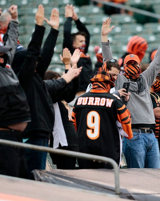 Cincinnati Bengals fans celebrate a field goal by Cincinnati Bengals kicker Randy Bullock (4) in the fourth quarter of the NFL Week 4 game between the Cincinnati Bengals and the Jacksonville Jaguars at Paul Brown Stadium in downtown Cincinnati on Sunday, Oct. 4, 2020. The Bengals collected their first win of the season, 33-25, from the Jaguars. Jacksonville Jaguars At Cincinnati Bengals