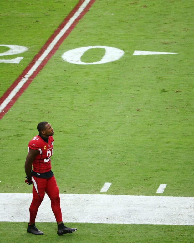 Arizona Cardinals cornerback Patrick Peterson (21) paces the sideline against the Detroit Lions in the first half at State Farm Stadium.