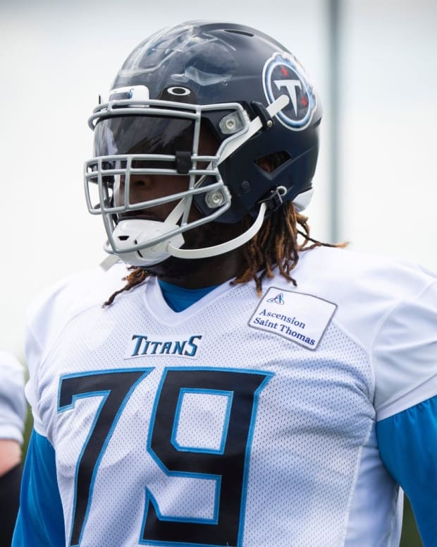 Tennessee Titans tackle Isaiah Wilson (79) warms up during a training camp practice at Saint Thomas Sports Park Friday, Aug. 14, 2020 in Nashville, Tenn.