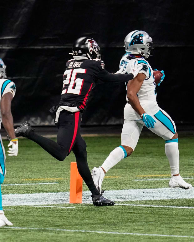 Oct 11, 2020; Atlanta, Georgia, USA; Carolina Panthers wide receiver DJ Moore (12) scores a touchdown behind Atlanta Falcons cornerback Isaiah Oliver (26) during the first half at Mercedes-Benz Stadium. Mandatory Credit: Dale Zanine-USA TODAY Sports