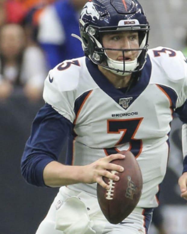 Denver Broncos quarterback Drew Lock (3) runs with the ball during the third quarter against the Houston Texans at NRG Stadium.