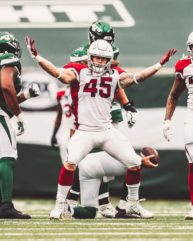Arizona Cardinals outside linebacker Dennis Gardeck (45) celebrating a sack.
