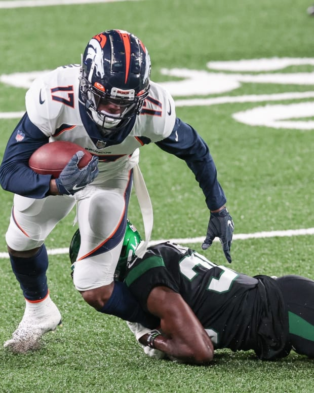 Denver Broncos wide receiver DaeSean Hamilton (17) is tackled by New York Jets cornerback Pierre Desir (35) during the first half at MetLife Stadium.