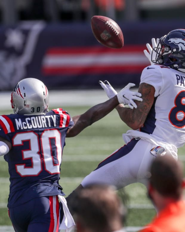 Denver Broncos receiver Tim Patrick (81) catches a pass while defended by New England Patriots cornerback Jason McCourty (30) during the first half at Gillette Stadium.