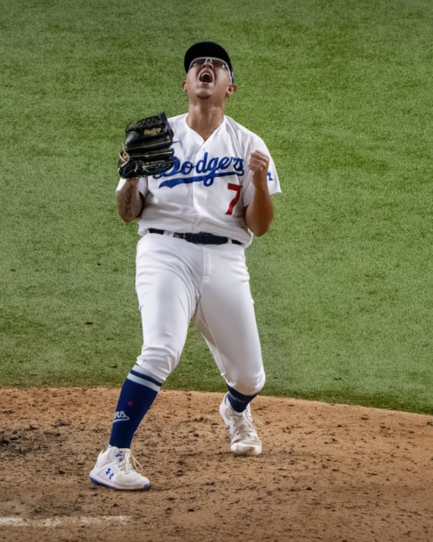 Oct 27, 2020; Arlington, Texas, USA; Los Angeles Dodgers relief pitcher Julio Urias (7) celebrates defeating the Tampa Bay Rays in game six of the 2020 World Series at Globe Life Field. Mandatory Credit: Jerome Miron-USA TODAY Sports