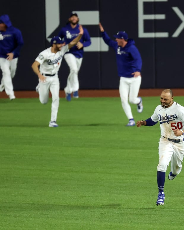 Oct 27, 2020; Arlington, Texas, USA; Los Angeles Dodgers right fielder Mookie Betts (50) celebrates winning the World Series against the Tampa Bay Rays after game six of the 2020 World Series at Globe Life Field. Mandatory Credit: Kevin Jairaj-USA TODAY Sports