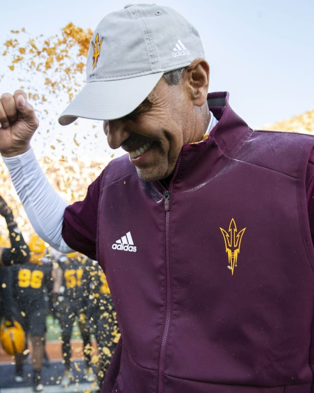 Dec 31, 2019; El Paso, Texas, USA; Arizona State Sun Devils head coach Herm Edwards is doused by Frosted Flakes by his players moments after defeating the Florida State Seminoles 20-14 in the Sun Bowl.
