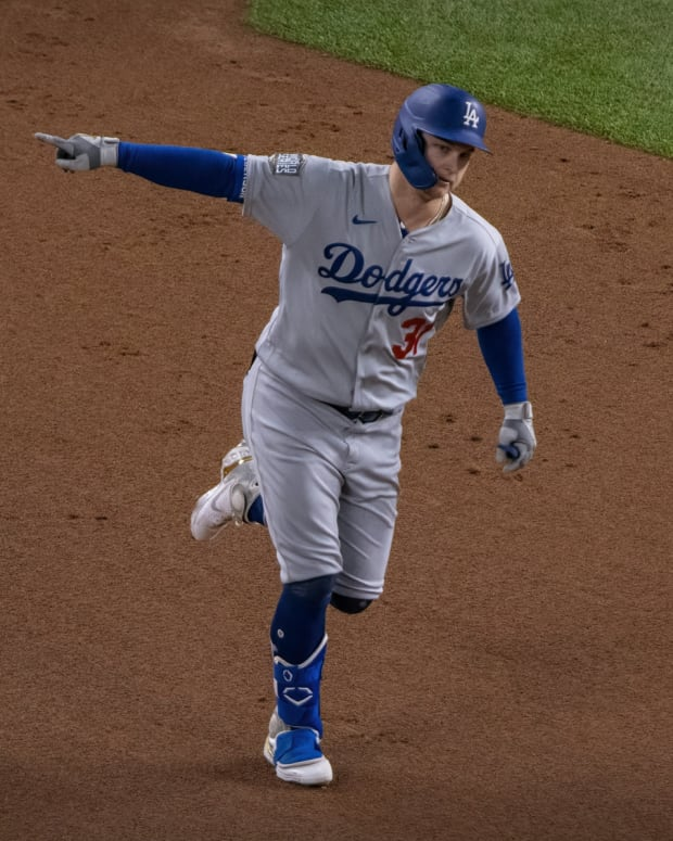 Oct 25, 2020; Arlington, Texas, USA; Los Angeles Dodgers left fielder Joc Pederson (31) hits a home run against the Tampa Bay Rays during the second inning in game five of the 2020 World Series at Globe Life Field. Mandatory Credit: Jerome Miron-USA TODAY Sports