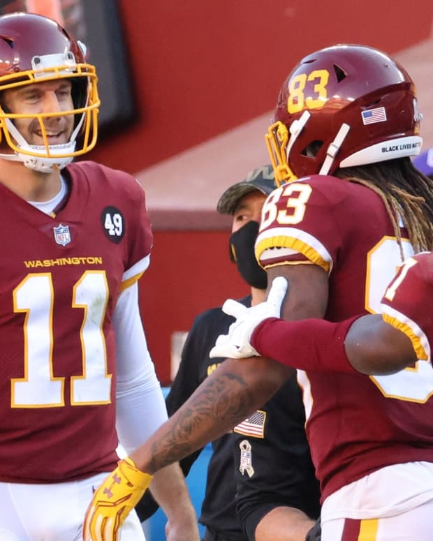 Nov 8, 2020; Landover, Maryland, USA; Washington Football Team quarterback Alex Smith (11) celebrates with Washington Football Team wide receiver Terry McLaurin (17) after the two connected on a touchdown pass against the New York Giants in the fourth quarter at FedEx Field.