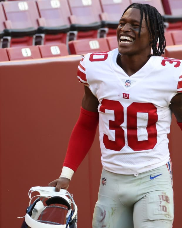 Nov 8, 2020; Landover, Maryland, USA; New York Giants cornerback Darnay Holmes (30) smiles while leaving the field after the Giants' game against the Washington Football Team at FedExField.