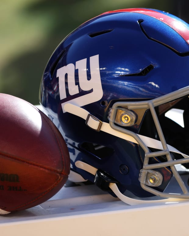 Nov 8, 2020; Landover, Maryland, USA; A view of the helmet of New York Giants kicker Graham Gano (not pictured) next to a ball on the sidelines against the Washington Football Team at FedEx Field.