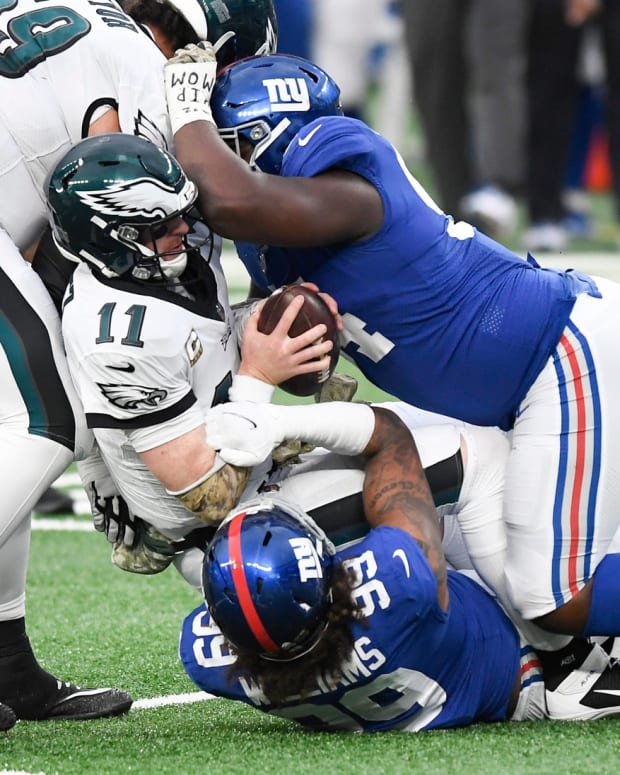 New York Giants defensive end Leonard Williams (99) and lineman Dalvin Tomlinson (94) sack Philadelphia Eagles quarterback Carson Wentz (11) in the second half. The Giants defeat the Eagles, 27-17, at MetLife Stadium on Sunday, Nov. 15, 2020.