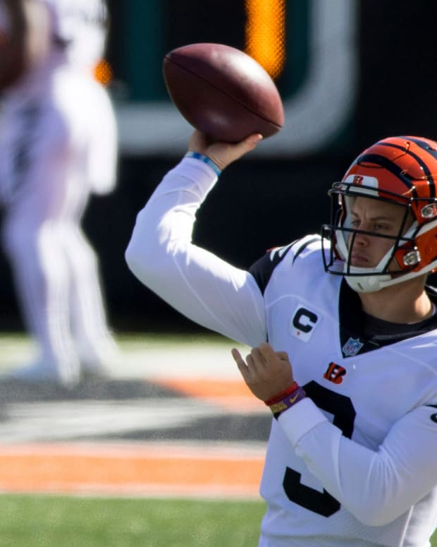 Cincinnati Bengals quarterback Joe Burrow (9) throws a pass while warming up before the Cincinnati Bengals and Tennessee Titans on Sunday, Nov. 1, 2020, in Cincinnati.