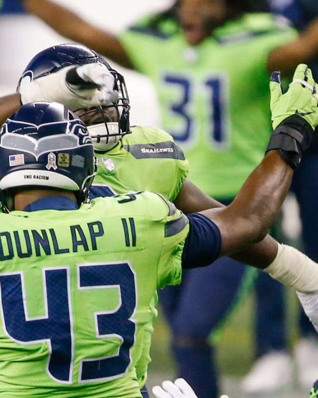 Nov 19, 2020; Seattle, Washington, USA; Seattle Seahawks defensive end Carlos Dunlap (43) celebrates with teammates following a fourth down sack against the Arizona Cardinals during the fourth quarter at Lumen Field. Mandatory Credit: Joe Nicholson-USA TODAY Sports