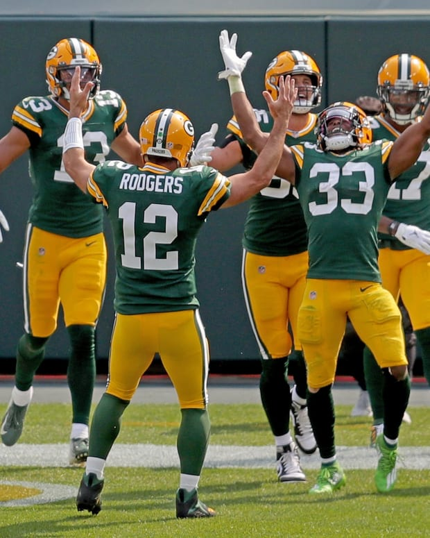 The Green Bay Packers celebrate an Aaron Jones (33) touchdown.