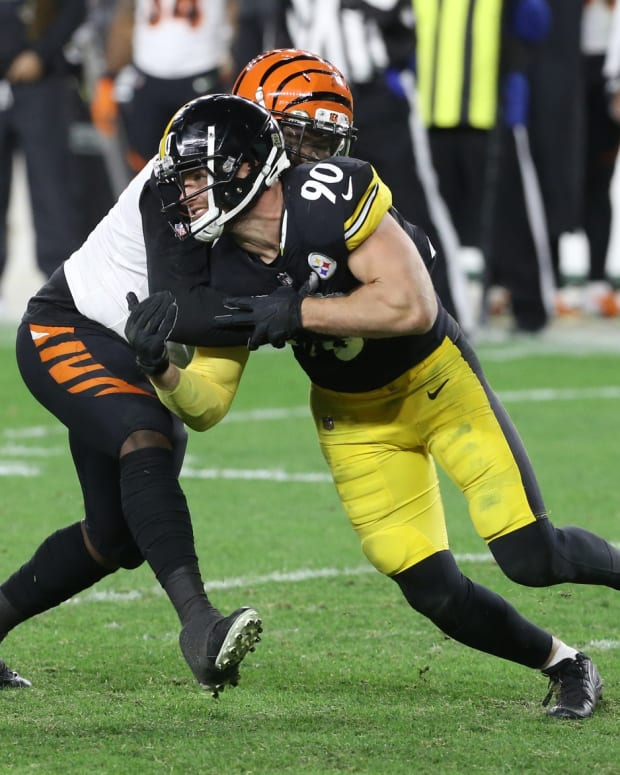 Nov 15, 2020; Pittsburgh, Pennsylvania, USA; Cincinnati Bengals offensive lineman Quinton Spain (left) blocks at the line of scrimmage against Pittsburgh Steelers outside linebacker T.J. Watt (90) during the third quarter at Heinz Field. The Steelers won 36-10. Mandatory Credit: Charles LeClaire-USA TODAY Sports