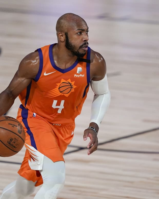 Phoenix Suns guard Jevon Carter (4) brings the ball up court against the Dallas Mavericks during the second half of an NBA basketball game Sunday, Aug. 2, 2020, in Lake Buena Vista, Fla.
