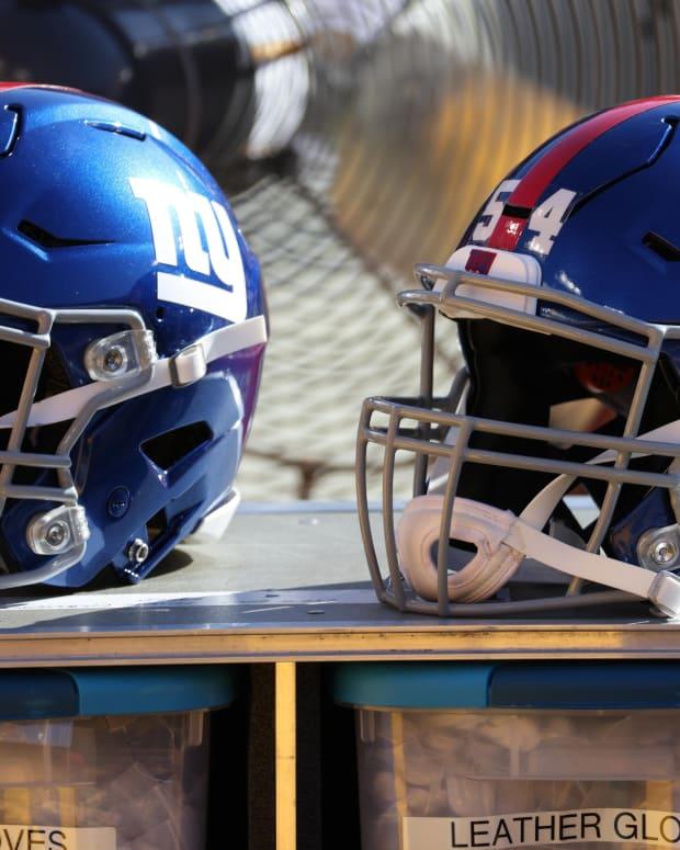 Nov 8, 2020; Landover, Maryland, USA; A view of the helmets of New York Giants quarterback Daniel Jones (8) and Giants inside linebacker Blake Martinez (54) resting on equipment case on the sidelines against the Washington Football Team at FedExField.