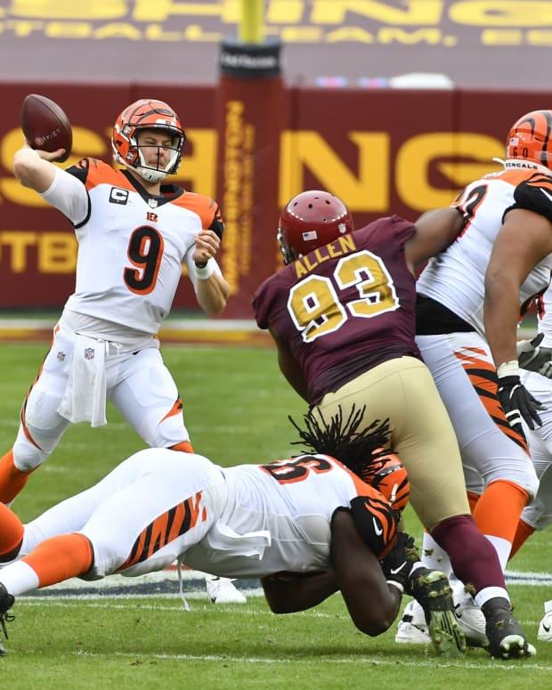 Nov 22, 2020; Landover, Maryland, USA; Cincinnati Bengals quarterback Joe Burrow (9) attempts a pass against the Washington Football Team during the second quarter at FedExField. Mandatory Credit: Brad Mills-USA TODAY Sports