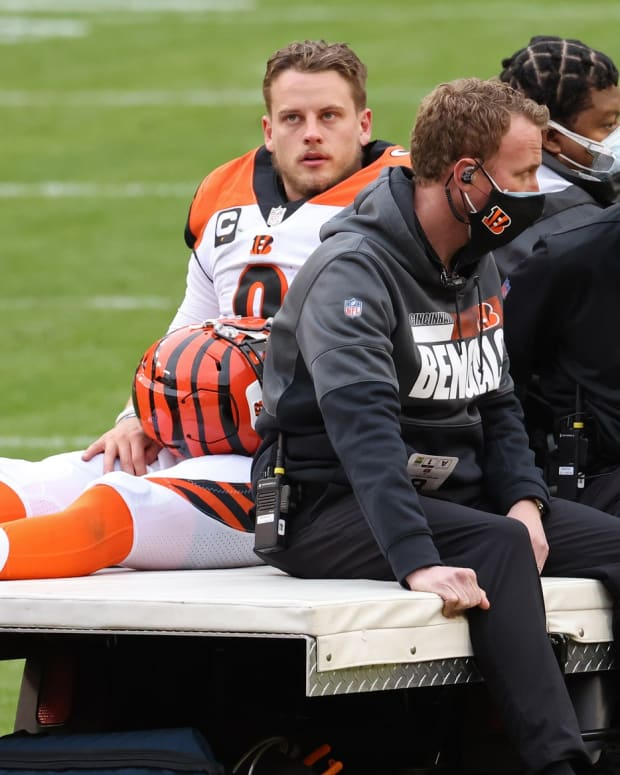 Nov 22, 2020; Landover, Maryland, USA; Cincinnati Bengals quarterback Joe Burrow (9) is carted off the field after injuring his left knee against the Washington Football Team in the third quarter at FedExField. Mandatory Credit: Geoff Burke-USA TODAY Sports