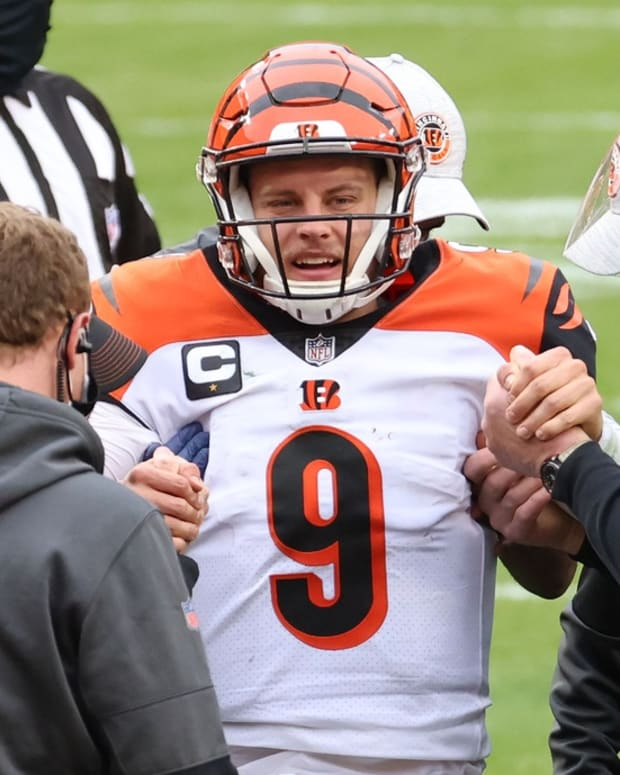 Nov 22, 2020; Landover, Maryland, USA; Cincinnati Bengals quarterback Joe Burrow (9) is helped onto a cart after injuring his left knee against the Washington Football Team in the third quarter at FedExField. Mandatory Credit: Geoff Burke-USA TODAY Sports