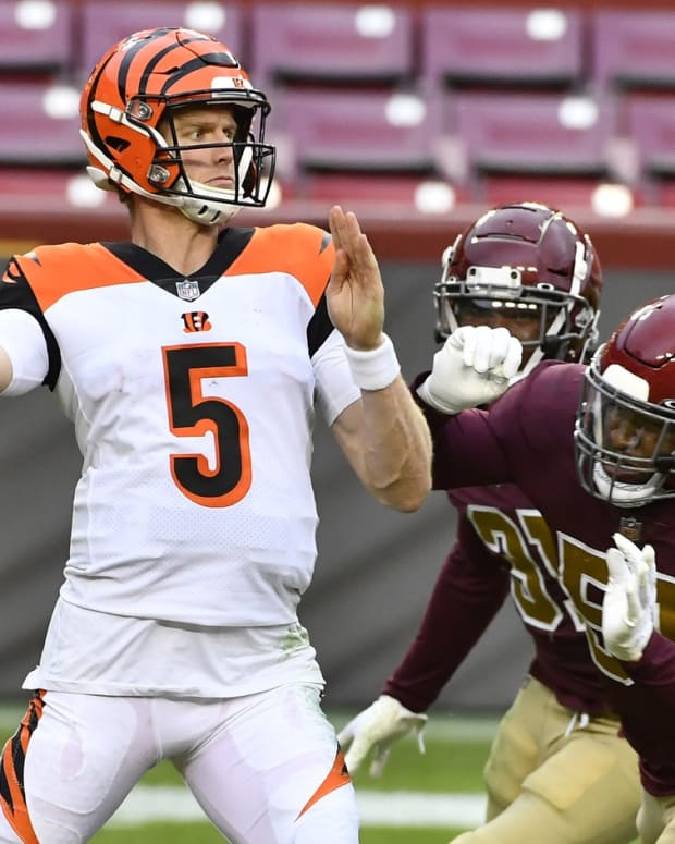Nov 22, 2020; Landover, Maryland, USA; Cincinnati Bengals quarterback Ryan Finley (5) attempts a pass as Washington Football Team outside linebacker Shaun Dion Hamilton (51) pressures during the second half at FedExField. Mandatory Credit: Brad Mills-USA TODAY Sports