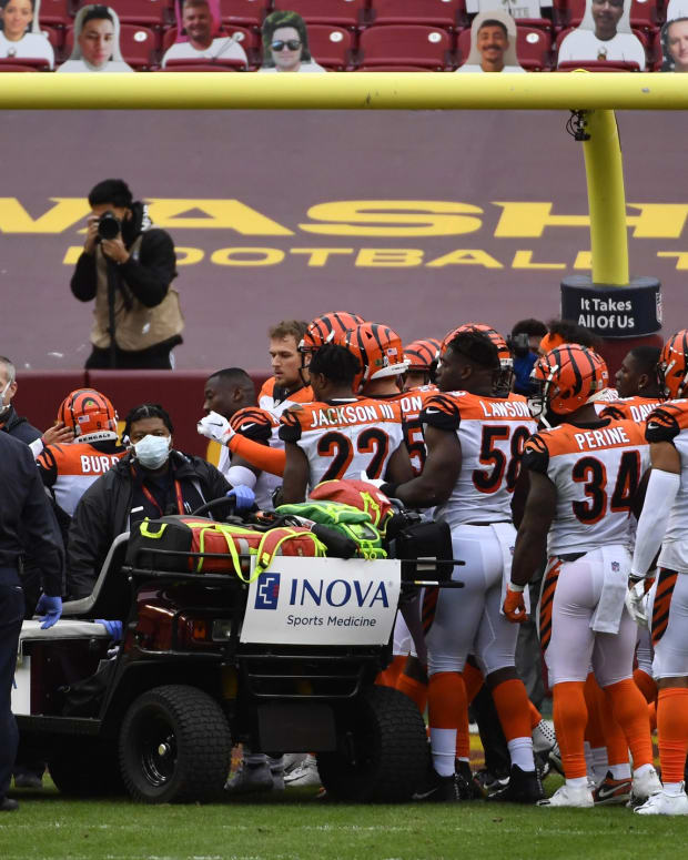 Nov 22, 2020; Landover, Maryland, USA; Cincinnati Bengals players console quarterback Joe Burrow (9) after suffering an apparent knee injury during the second half against the Washington Football Team at FedExField. Mandatory Credit: `