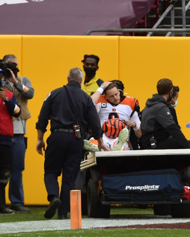 Nov 22, 2020; Landover, Maryland, USA; Cincinnati Bengals quarterback Joe Burrow (9) leaves the field after suffering an apparent knee injury during the second half against the Washington Football Team at FedExField. Mandatory Credit: Brad Mills-USA TODAY Sports