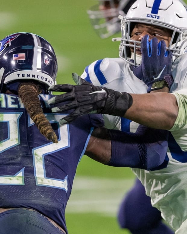 Derrick Henry (22) of the Tennessee Titans works against Grover Stewart (90) of the Indianapolis Colts, Indianapolis Colts at Tennessee Titans, Nissan Stadium, Nashville, Thursday, Nov. 12, 2020. Colts won 34-17. 54 Coltstitans Rs