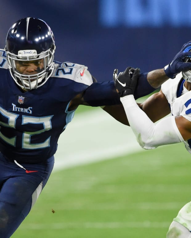 Tennessee Titans running back Derrick Henry stiff-arms Indianapolis Colts safety Khari Willis in a Week 10 game in Nashville, Tenn.