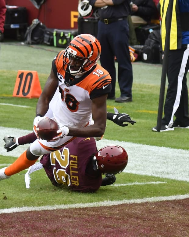 Nov 22, 2020; Landover, Maryland, USA; Cincinnati Bengals wide receiver A.J. Green (18) scores a touchdown as Washington Football Team cornerback Kendall Fuller (29) defends during the second quarter at FedExField. Mandatory Credit: Brad Mills-USA TODAY Sports