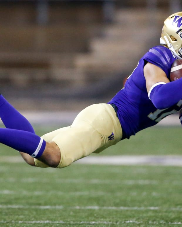 Nov 28, 2020; Seattle, Washington, USA; Washington Huskies wide receiver Puka Nacua (12) catches a pass against the Utah Utes during the fourth quarter at Alaska Airlines Field at Husky Stadium. Mandatory Credit: Joe Nicholson-USA TODAY Sports