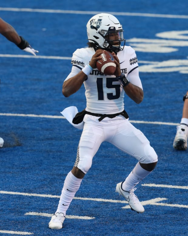 Oct 24, 2020; Boise, Idaho, USA; Utah State Aggies quarterback Jason Shelley (15) looks for a receiver during the first half versus the Boise State Broncos at Albertsons Stadium.