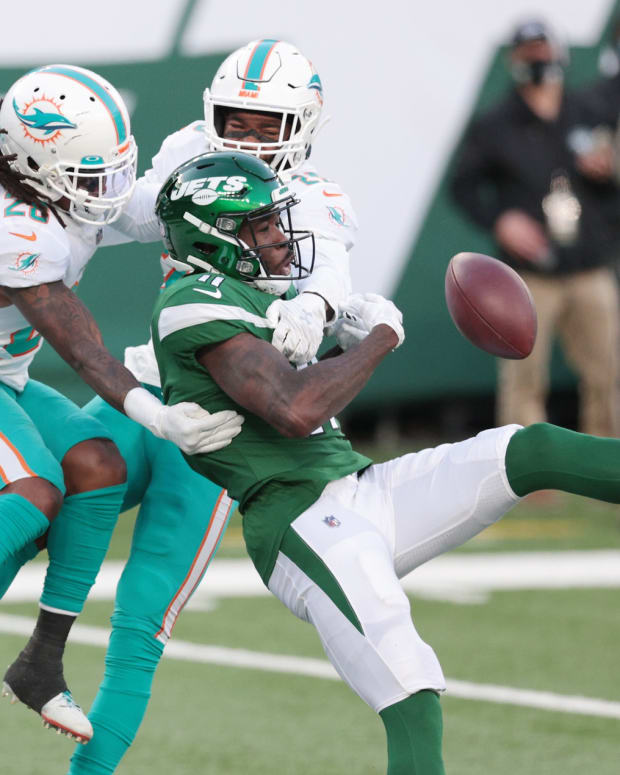 Jets WR Denzel Mims tries to make catch defended by Dolphins secondary
