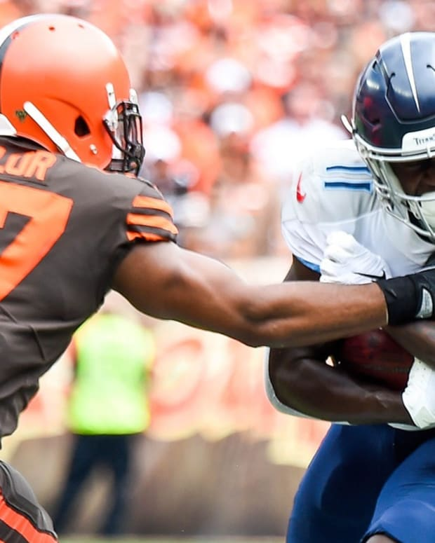 Tennessee Titans wide receiver A.J. Brown (11) pulls in a catch against Cleveland Browns outside linebacker Adarius Taylor (57) during the first quarter at FirstEnergy Stadium Sunday, Sept. 8, 2019 in Cleveland, Ohio.