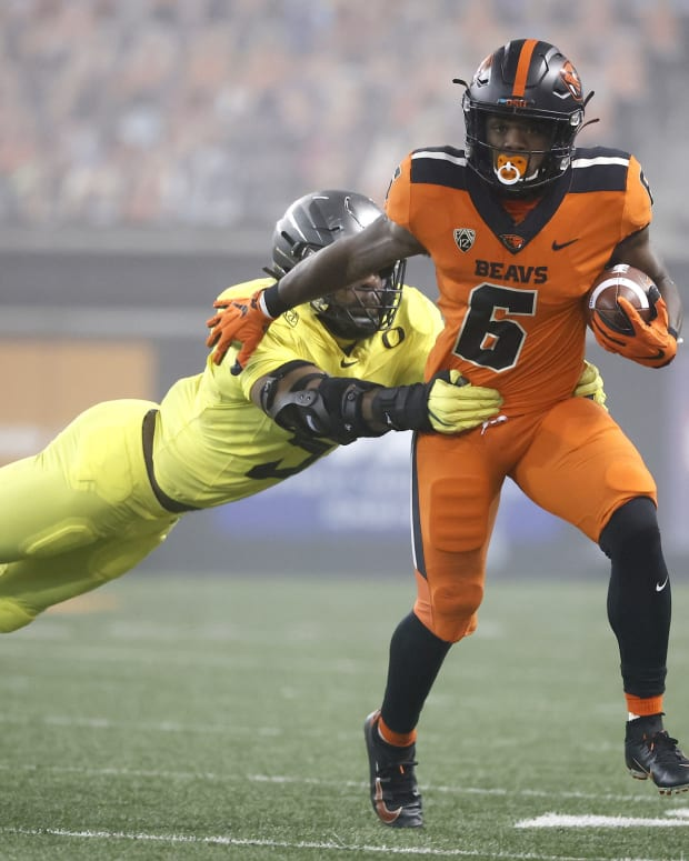 Nov 27, 2020; Corvallis, Oregon, USA; Oregon State Beavers running back Jermar Jefferson (6) runs the ball against Oregon Ducks defensive end Kayvon Thibodeaux (5) during the first half at Reser Stadium.