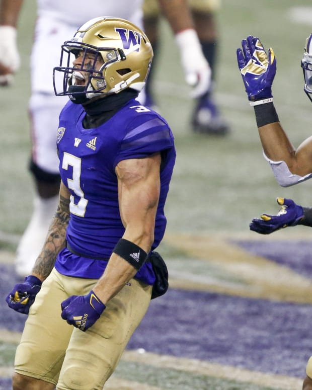 Nov 28, 2020; Seattle, Washington, USA; Washington Huskies defensive back Elijah Molden (3) and defensive back Alex Cook (5) react following a third down stop against the Utah Utes during the fourth quarter at Alaska Airlines Field at Husky Stadium.