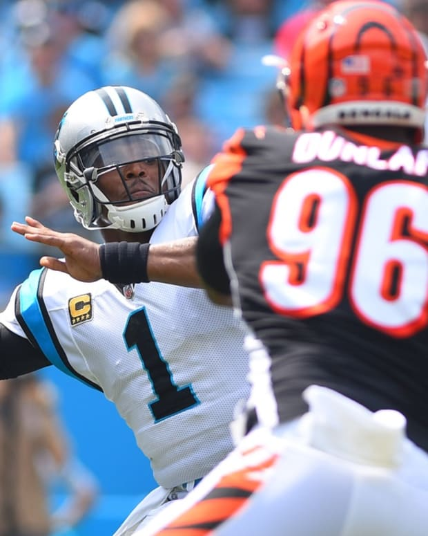 Sep 23, 2018; Charlotte, NC, USA; Carolina Panthers quarterback Cam Newton (1) looks to pass as Cincinnati Bengals defensive end Carlos Dunlap (96) pressures in the first quarter at Bank of America Stadium. Mandatory Credit: Bob Donnan-USA TODAY Sports