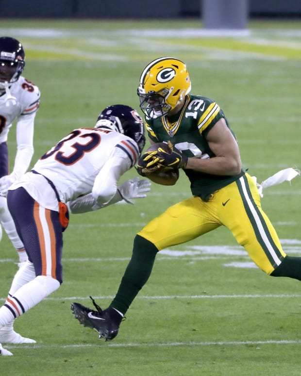 Green Bay Packers wide receiver Allen Lazard (13) catches a pass in front of the Chicago Bears cornerback Jaylon Johnson (33) on Sunday, November 29, 2020, at Lambeau Field in Green Bay, Wis
