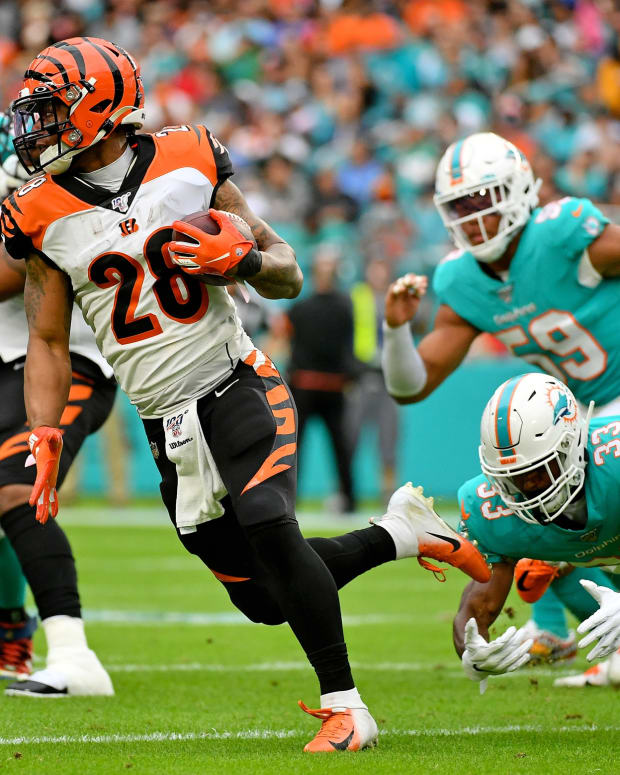 Dec 22, 2019; Miami Gardens, Florida, USA; Cincinnati Bengals running back Joe Mixon (28) rushes with the ball against the Miami Dolphins during the first half at Hard Rock Stadium. Mandatory Credit: Jasen Vinlove-USA TODAY Sports