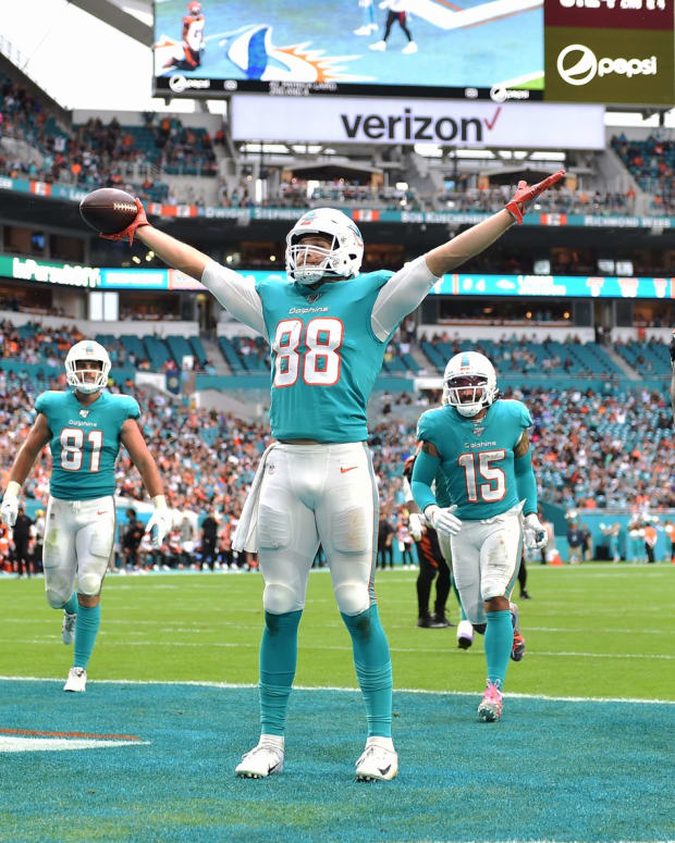 Dec 22, 2019; Miami Gardens, Florida, USA; Miami Dolphins tight end Mike Gesicki (88) celebrates his touchdown catch against the Cincinnati Bengals during the second half at Hard Rock Stadium. Mandatory Credit: Steve Mitchell-USA TODAY Sports