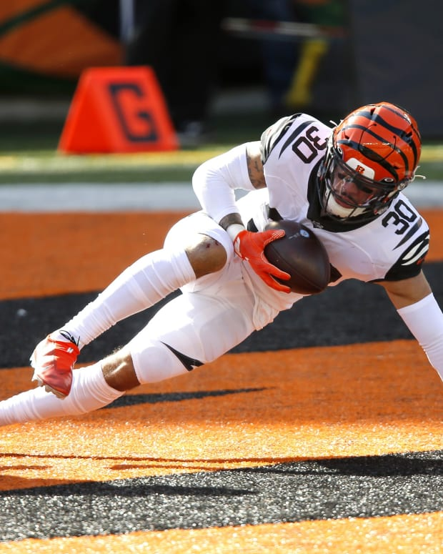 Nov 1, 2020; Cincinnati, Ohio, USA; Cincinnati Bengals free safety Jessie Bates (30) makes an interception against the Tennessee Titans during the first quarter at Paul Brown Stadium. Mandatory Credit: Joseph Maiorana-USA TODAY Sports